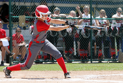 ANNA NORRIS/CHRONICLE Elyria's Dierra Hammons hits a single in the third inning against Brecksville in the regional championship game Saturday afternoon at Clyde High School.