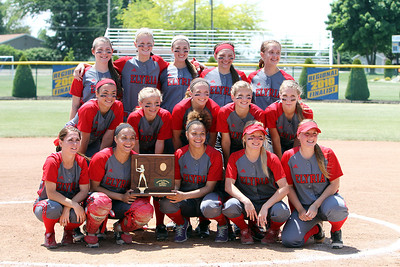 ANNA NORRIS/CHRONICLE The Elyria Lady Pioneer softball team takes a team photo with their regional championship trophy after beating Brecksville 4-0 Saturday.