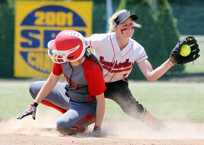 ANNA NORRIS/CHRONICLE Elyria's Alex Dick slides into second before Brecksville's Alexis Mack can make the tag in the fourth inning of the Division I Regional 2 championship game at Clyde High School Saturday afternoon.