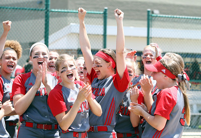 ANNA NORRIS/CHRONICLE The Elyria Lady Pioneers softball team celebrate their 4-0 victory over Brecksville in the Divison I regional championship game.