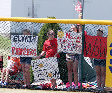 ANNA NORRIS/CHRONICLE Elyria fans show their support for the Lady Pioneers in the outfield during the Division I Regional 2 championship game at Clyde High School Saturday afternoon.