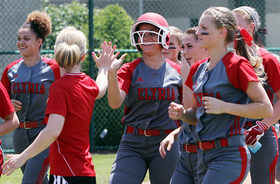 ANNA NORRIS/CHRONICLE Elyria's Kaitlyn Laseke high fives Elyria coach (need name) after hitting an out-of-the-park home run in the second inning against Brecksville in the Division I Regional 2 championship game Saturday afternoon at Clyde High School.
