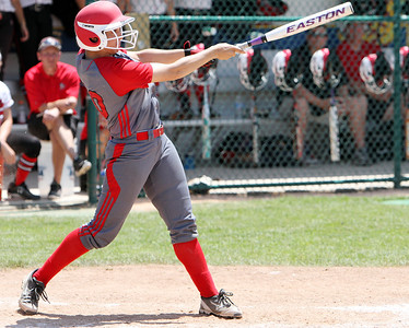 ANNA NORRIS/CHRONICLE Elyria's Kaitlyn Laseke hits an RBI home run in the sixth inning to take a 4-0 lead over  Brecksville in the Division I Regional 2 championship game at Clyde High School Saturday afternoon.