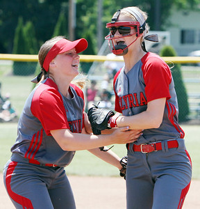ANNA NORRIS/CHRONICLE Elyria's Elizabeth Ellis, left, celebrates with short stop Carly Bachna after Bachna threw out the base runner at first to close out the top of the sixth inning against Brecksville in the regional championship game Saturday afternoon.