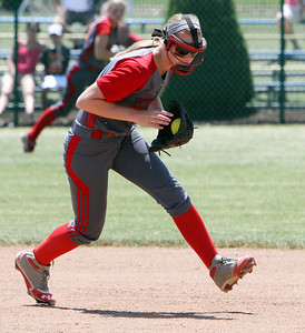 ANNA NORRIS/CHRONICLE Elyria short stop Carly Bachna scoops up the ground ball against Brecksville in the sixth inning in the regional championship game at Clyde High School Saturday afternoon.