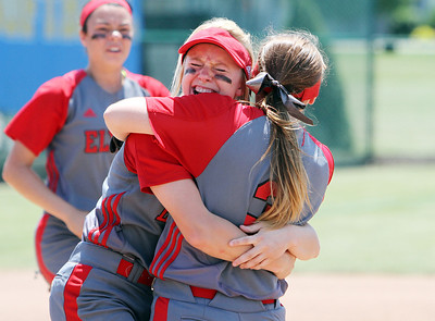 ANNA NORRIS/CHRONICLE Elyria's Madison Fullmer hugs Elizabeth Ellis after the Lady Pioneers beat Brecksville 4-0 to win the Division I regional championship game advancing to the state tournament for the eighth time in nine years Saturday afternoon at Clyde High School.