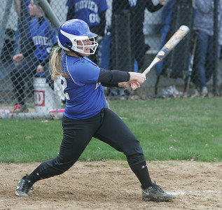 Midview's #22 Grace Turner launches a double.    photo by Chuck Humel