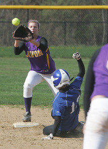 Midview's #13 Heather Miller is forced out at second with the throw to Avon's #11 Cora Chachat photo by Chuck Humel