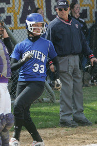 Midview #33 Delaina DiVencenzo crosses the plate.  photo by Chuck Humel