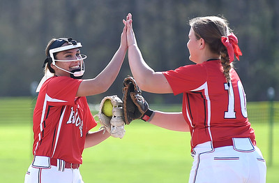 KRISTIN BAUER | CHRONICLE Firelands High School pitcher Sam Hribal (3) high-fives first baseman Hailey Blankenship (10) after striking out a Brookside High School batter on Tuesday evening, May 3.