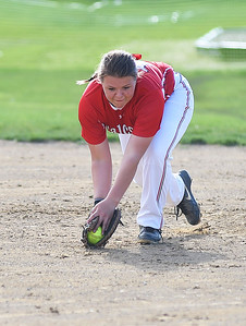 KRISTIN BAUER | CHRONICLE Firelands High School first baseman Hailey Blankenship (10) lunges in the nick of time to catch a popfly for an out against Brookside High School on Tuesday evening, May 3.