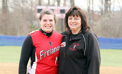 Firelands High School varsity softball head coach Judy Dostall, right, will be stepping down after 19 years as head coach at the end of this season so she can watch her daughter, Samantha Dostall, left, play college softball at Baldwin-Wallace College. (CT photo by Anna Norris.)