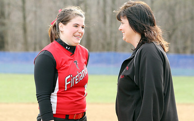 Firelands High School pitcher senior Samantha Dostall, left, talks with her head coach, and mother, Judy Dostall, following the Falcons loss to Keystone at South Amherst Middle School. Coach Dostall is stepping down at the end of the season after 19 years to watch Samantha play college softball at Baldwin-Wallace in Berea. (CT photo by Anna Norris.)