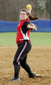 Firelands pitcher Samantha Dostall winds up to pitch against Keystone in the seventh inning at South Amherst Middle School. Firelands High School pitcher senior Samantha Dostall, left, talks with her head coach, and mother, Judy Dostall, following the Falcons loss to Keystone Monday at South Amherst Middle School. Coach Dostall is stepping down at the end of the season after 19 years to watch Samantha play college softball at Baldwin-Wallace in Berea. (CT photo by Anna Norris.)