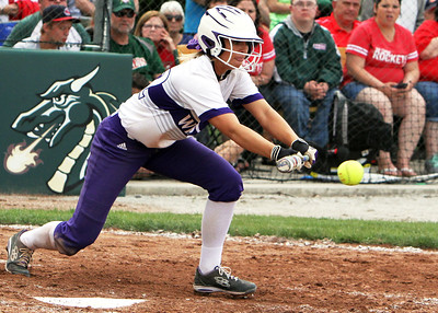ANNA NORRIS/CHRONICLE Keystone's Paige Hartley puts down the bunt against Oak Harbor in the division II regional final game Saturday afternoon at Tiffin University.