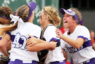 ANNA NORRIS/CHRONICLE From left to right, Keystone's Shelby Campbell (42), catcher Summer Metcalf, center, and Paige Hartley, right, celebrate at home plate after clinching the division II regional championship 2-0 over Oak Harbor Saturday afternoon at Tiffin University and advancing to the state tournament in Akron.