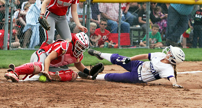 ANNA NORRIS/CHRONICLE Keystone's Marlie McNulty slides into third base on a steal as Oak Harbor catcher Maddy Rathbun drops the ball unable to make the tag in the sixth inning of the division II regional final game at Tiffin University Saturday afternoon.