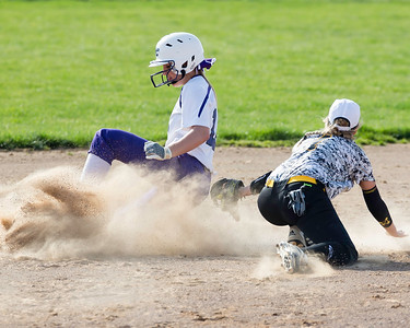 Keystone's Paige Hartley slides safely into second for the steal as Black River's Elizabeth Rogers tries to apply the tag during a game Monday, April 18. JOE COLON/CHRONICLE