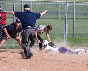 The umpire calls Keytstone's Summer Constable safe as she slides into third under Madison Combs' tag in a game against Black RIver on Monday, April 18. JOE COLON/CHRONICLE