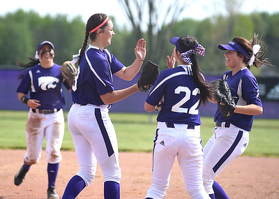 KRISTIN BAUER | CHRONICLE   Keystone High School shortstop Summer Constable (00), firstbaseman Brooke Piazza (22) and second baseman Kodi Akers (18) celebrate a strike out by pitcher Lauren Shaw (8) on Wednesday afternoon, May 18 during a district softball final.