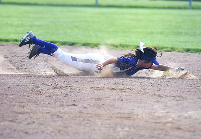 KRISTIN BAUER | CHRONICLE   Keystone High School second baseman Kodi Akers (18) dives to stop a fast-moving ground ball to assist making an out at first on Wednesday afternoon, May 18 during a district softball final game against Cloverleaf.