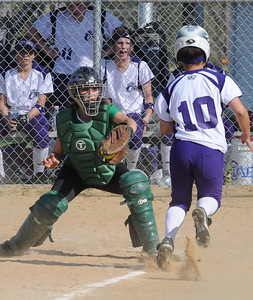 Columbia Emily Nagle makes a put out on Keystone Taylor Ford at the plate in third inning Apr. 21.   Steve Manheim