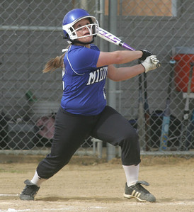 Midview #22 Grace Turner belts a two-run triple to ad insurance runs against Magnificat.  photo by Chuck Humel