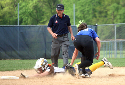 Midview's Amanda Beursken puts the tag on North Ridgeville's Kendra Moore at second base.