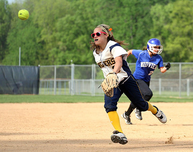The ball sails past the Rangers' Marissa Carraballo as Midview's Brittney Swanzer heads for third base during sectional play at North Ridgeville.
