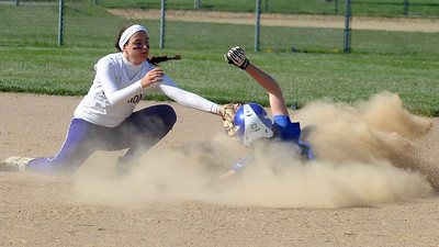 Midview's Amanda Beursken steals second base before the tag by Vermilion's Katelynn Urgo in first inning.   Steve Manheim