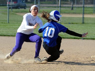 Midview's Erin DiFranco is tagged out  on steal attempt by Vermilion's Katelynn Urgo in third inning.  Steve Manheim