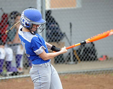 Midview's  Cassie Haight hits an infield sacrifice to drive in a run in the first inning April 21.  STEVE MANHEIM/CHRONICLE