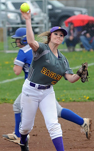 Avon's Alexis Dill makes a throw to first base April 21.  STEVE MANHEIM/CHRONICLE