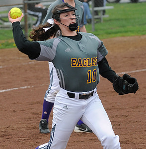 Avon's Tina Clark makes a throw to first base April 21.  STEVE MANHEIM/CHRONICLE