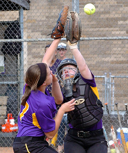 Avon's catcher #18 Emily Rogers and #17 Ally Sumser collide as they try to catch a popup behind home plate.