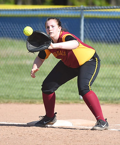 KRISTIN BAUER | CHRONICLE Avon Lake High School first baseman Reilly Naylon (22) makes an out at first base during a game against Olmsted Falls on Tuesday afternon, May 9.