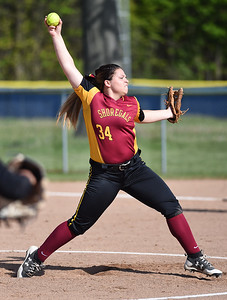KRISTIN BAUER | CHRONICLE Avon Lake High School pitcher Gwyn Lester (34) pitches against Olmsted Falls High School on Tuesday night, May 9.
