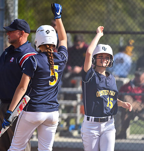 KRISTIN BAUER | CHRONICLE Olmsted Falls High School's Nicole O'Neill (5) and Peyton Bielski (15) celebrate after scoring 3 runs against Avon Lake High School on Tuesday afternoon, May 9.