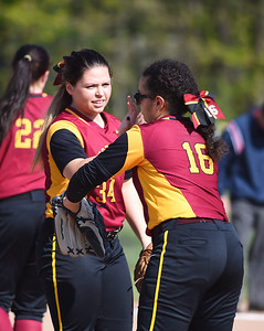 KRISTIN BAUER | CHRONICLE Avon Lake High School pitcher Gwyn Lester (34) high-fives teammate and thirdbaseman Kassidy Malton (16) after striking out an Olmsted Falls High School batter on Tuesday night, May 9.