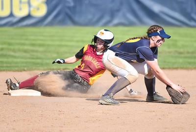 KRISTIN BAUER | CHRONICLE Avon Lake High School's Sydney Petonic (24) slides safely into second base as Olmsted Falls High School shortstop Ashley Zgodzinski (29) fails to secure the ball in time to make the tag on Tuesday afternoon, May 9.