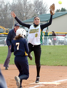 Amherst's #8 Alexis Torres can't get a handle on the ball as OF's #7 Kelly Kirkpatrick makes it safely to 1st.