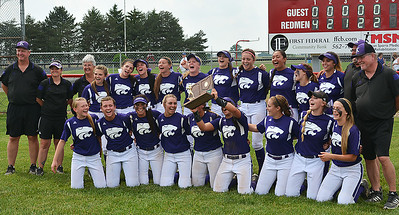 "Singing and swaying to Neil Diamond's ""Sweet Caroline,"" the Keystone softball team hold aloft the regional championship trophy they earned by defeating Maumee 11-0 in five innings Sunday. BILL KEATON/CHRONICLE"