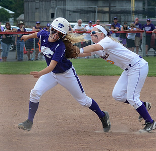 Keystone's Shelby Fortune is chased down and tagged out by Maumee's Nicole Archambeau after a fly ball Sunday in a regional final between Keystone and Maumee. BILL KEATON/CHRONICLE