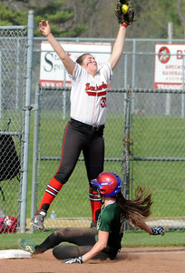 Westlake's Erin Brown slides safely into third as Brecksville's Dani D'Anna catches the ball. STEVE MANHEIM/CHRONICLE