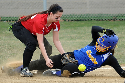 Clearview Sarah Kaya slides safe into third for an RBI triple in first inning Apr. 10.  Brookside 3B is Kirsten Lara.    Steve Manheim