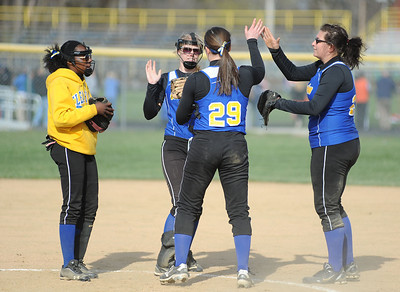 Clearview's Sarah Kaya (29) and her teammates celebrate after a strikeout against Wellington. KRISTIN BAUER | CHRONICLE