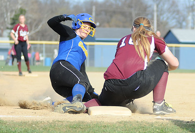 Clearview's Chelsea Kincer slides safely into third base after hitting a triple as Wellington third baseman Brittney Wallace attempts to tag her. KRISTIN BAUER | CHRONICLE
