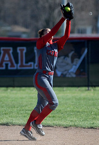 Elyria short stop Kandis Laseke catches a flyball against Brunswick on Tuesday, April 23. KRISTIN BAUER | CHRONICLE