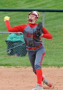 Elyria Carly Bachna makes a throw to first base May 5.  Steve Manheim