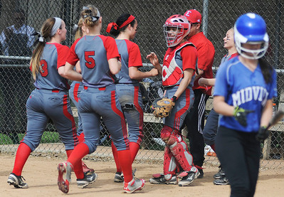 Elyria celebrates a good inning against Midview. KRISTIN BAUER | CHRONICLE